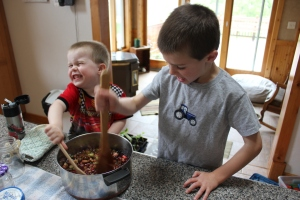 The boys are both great help in the kitchen. Here they are gently stirring in a 3 oz package of Jello until dissolved.