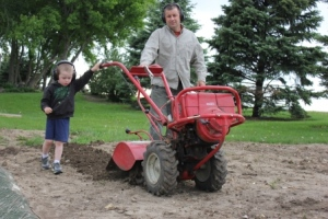 Sam helped Steve re-till part of the garden to finish planting some broom corn as well as another planting of sugar snap peas and green beans.