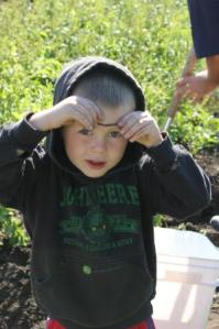 When we were digging potatoes, Sam is still all about finding the worms! He finds that the worms and the potatoes are both treasurers.