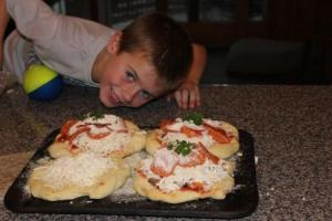 The kids love making their own individual pizzas. I let them have a piece of dough to shape into their own. Lots of fun!