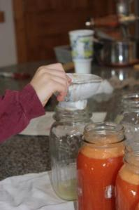 Next Keith helped to fill the jars leaving about an inch of head space between the juice and the lid.
