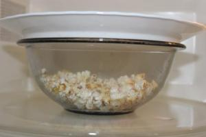 Some of you may be wondering how do I pop this popcorn? I have always bought microwave popcorn. Great news...simply put some popcorn in a Pyrex bowl and cover with a plate and pop for about 3 minutes or about the length you usually pop microwave popcorn in your microwave (seems every microwave varies a little). Once you hear the kernels stop popping - its done. Another option is to use a brown lunch bag, fold over the top about 3 times and place in microwave for about 2-3 minutes. Remove when you hear the kernels stop popping.