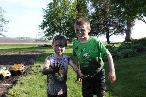 """Of course, all work and no play doesn't work well. The boys again found great joy in looking for worms and creating their own """"pool."""""""