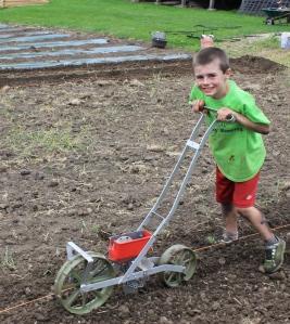 5-25-14 Keith planting broom corn