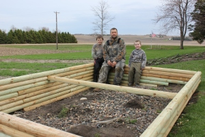 The boys worked hard and framed it up last weekend. And filled it with composted soil last week.