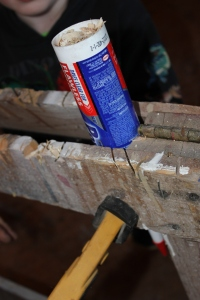 Our gadget to make the tubes with is a caulk tube which is clamped onto a sawhorse.