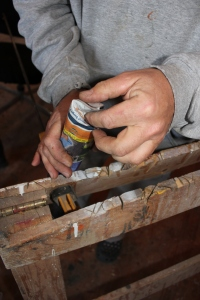 Once it is wrapped around your tube, twist the access and push/fold down into the bottom of the caulk tube.