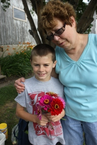 Some day Keith will value the opportunity he had to gather a bouquet of flowers for his Grandma's share in the CSA.