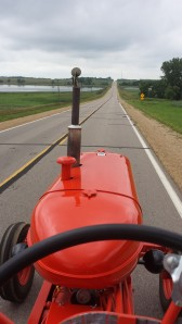This weekend was my hometown celebration. My dad has restored 10 Allis Chalmers tractors. Every year, we help him bring the tractors in for display. I had the privilege of driving my Grandpa's WD45 that dad restored. It was a relaxing view into town.