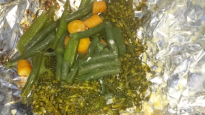 Place on grill for about 8 minutes flipping aluminum packet once which is filled with above vegetable mixture, olive oil, cheese and herbs. Unwrap and enjoy.