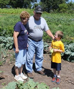 Sam showed his grandparents how to harvest a kohlrabi. His grandparents have been farming for over 50 years and always enjoy learning about different types of agriculture.