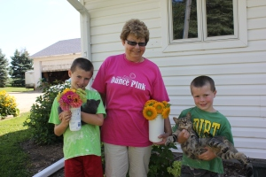 The boys wee happy to share some flowers with their Grandma.