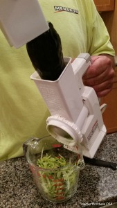 Shredding zucchini is super easy and fun with this salad shooter.